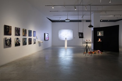 Installation view. The Question of Intelligence (Sheila C. Johnson Design Center, The New School). From left to right: Mary Flanagan, [Grace:AI], 2019 (11 dye sublimation prints on aluminum, 20 x 20 in. / 10 x 10 in., Electric Philosophy [Grace:AI] [...]